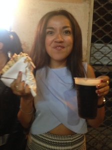 Grace's first Guinness with a pizza in hand of course